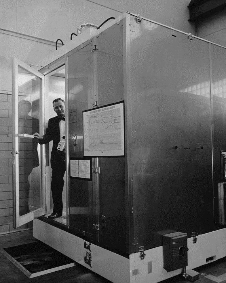 Willis Whitfield leaving an early clean room. Courtesy of Sandia National Laboratories