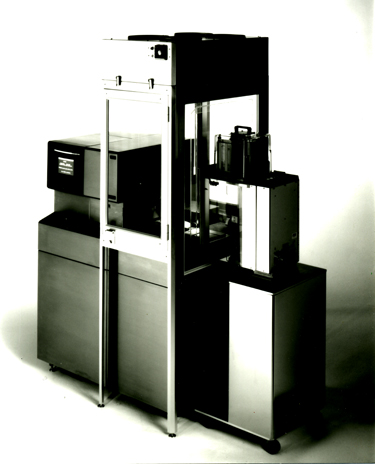 The Asyst-SMIF System is integrated with a Tencor surscan 7200